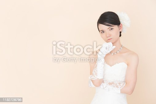 istock Bride wearing a wedding dress 1132728795