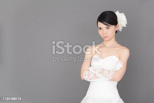 istock Bride wearing a wedding dress 1134198174