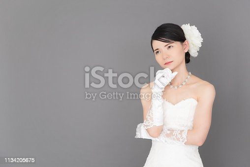 istock Bride wearing a wedding dress 1134205675