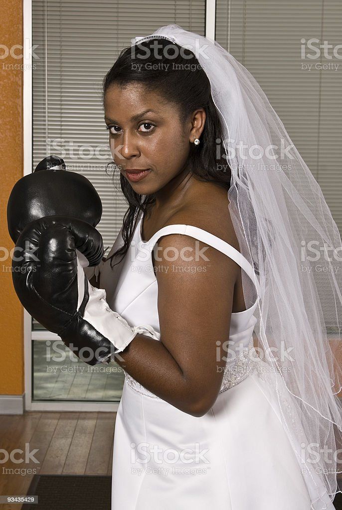 Bride wearing boxing gloves stock photo