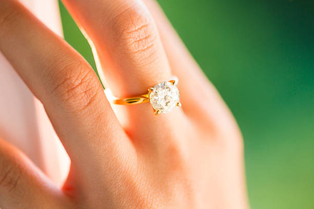 bride wearing diamond ring - diamond ring hand stock photos and pictures