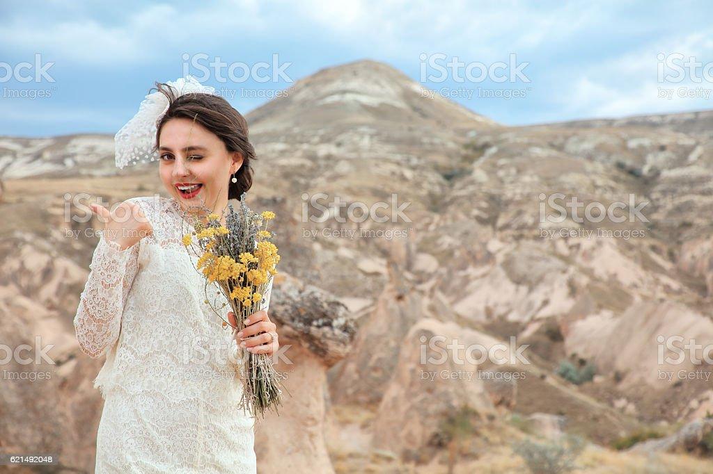 Bride winking and okay gesture in Cappadocia, Turkey Lizenzfreies stock-foto