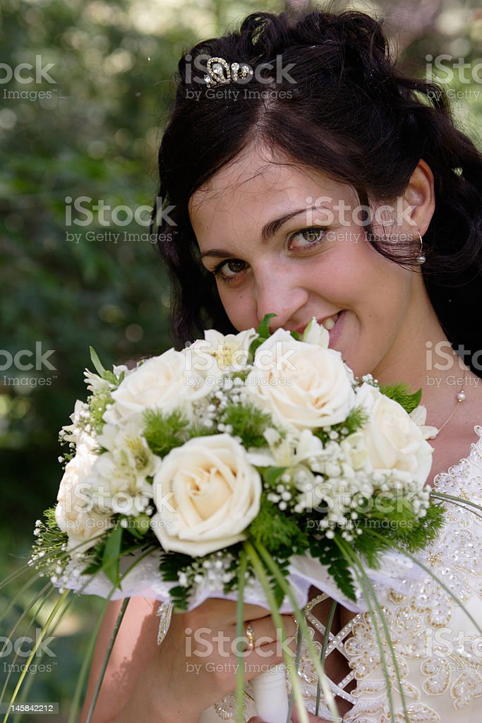 Bride with a bunch of flowers royalty-free stock photo