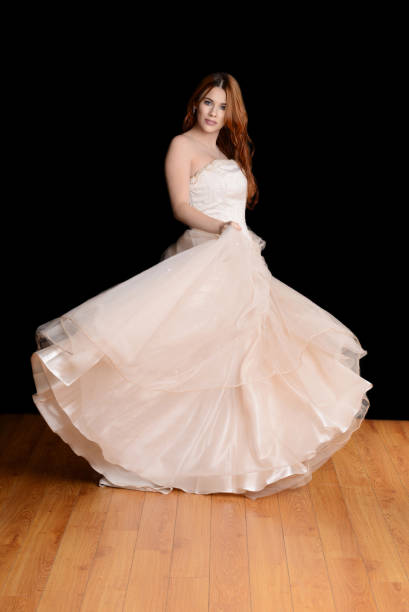 bride with beautiful tulle gown dancing - hochzeitskleider canda stock-fotos und bilder