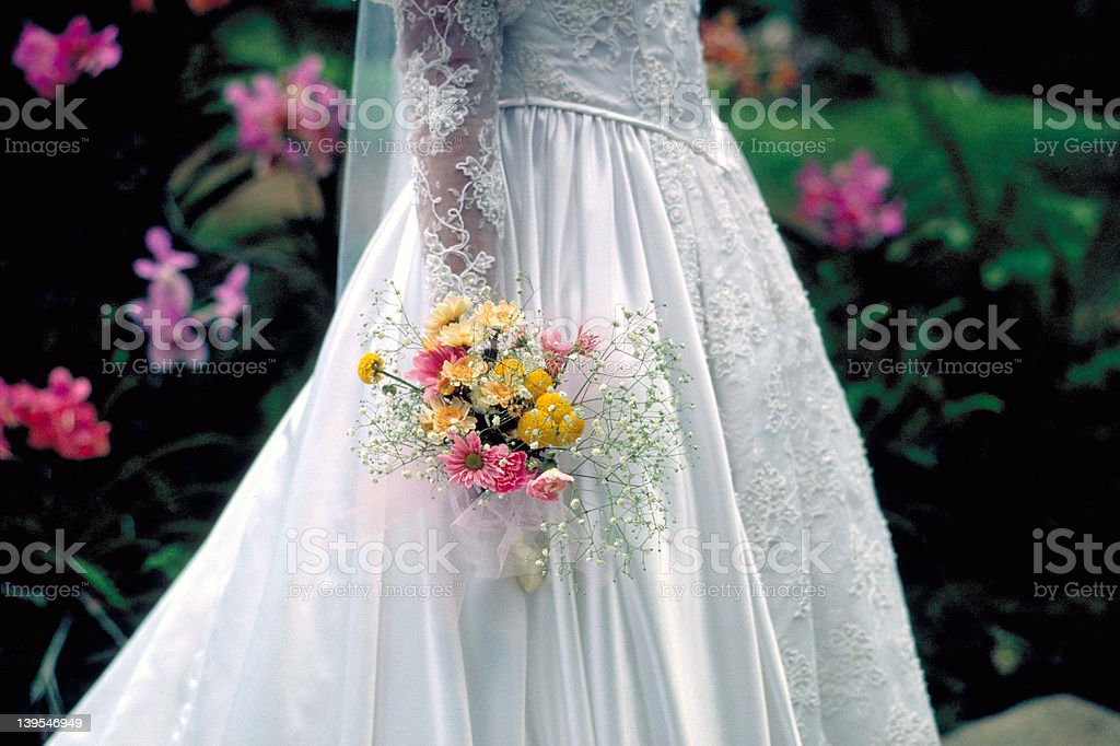 Bride with bouquet of flowers royalty-free stock photo