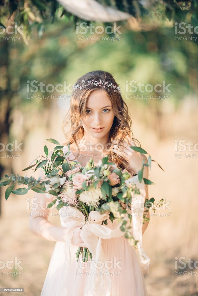 bride with bouquet of flowers stock photo