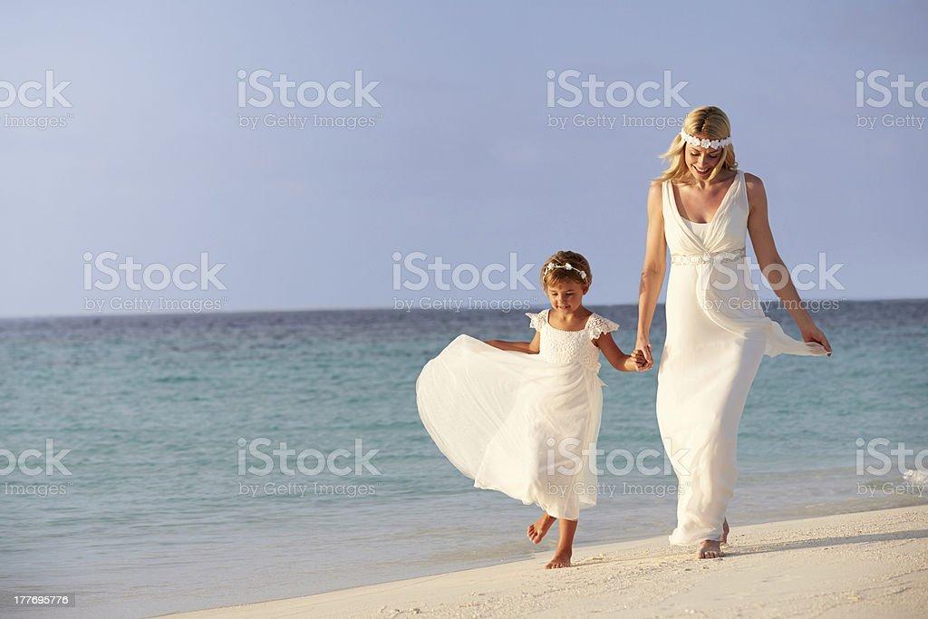 Bride With Bridesmaid At Beautiful Beach Wedding royalty-free stock photo