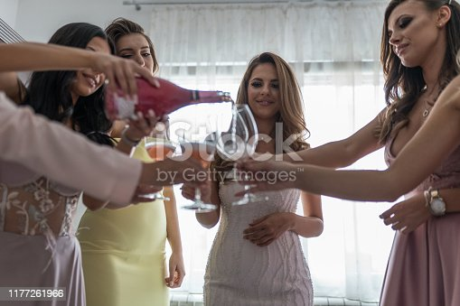 Bride with bridesmaids at wedding day