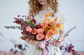 istock Bride with colorful autumn bouquet 1270509088