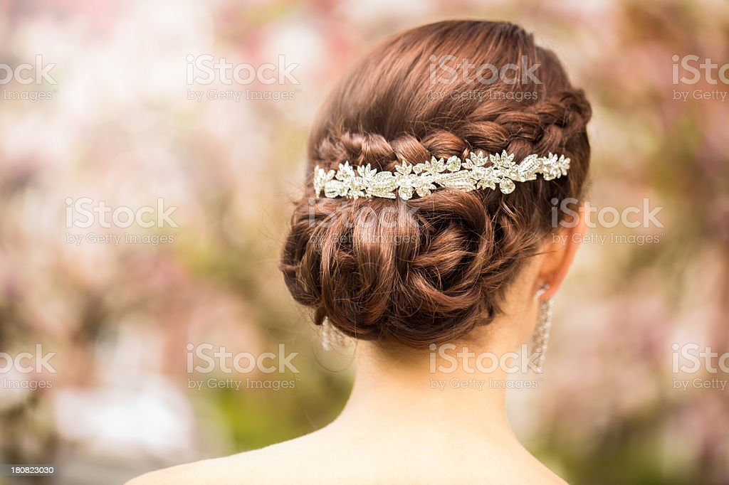 Bride with elegant tiara in wedding hairstyle stock photo