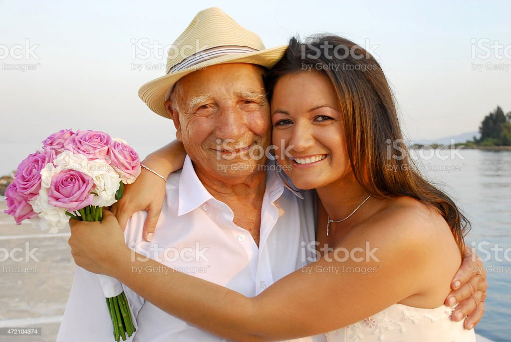 Bride with grandfather stock photo