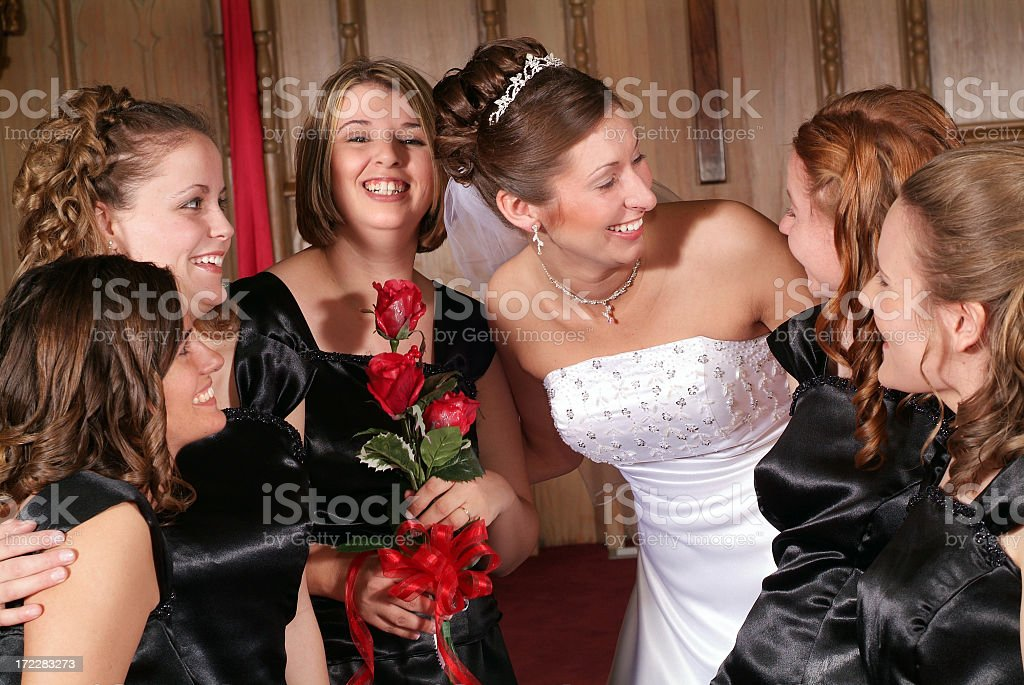 Bride with Her Bridesmaids Before the Wedding in the Church royalty-free stock photo
