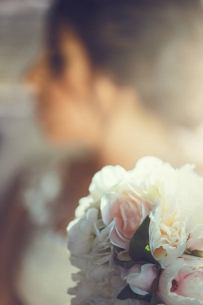Bride with her wedding bouquette stock photo