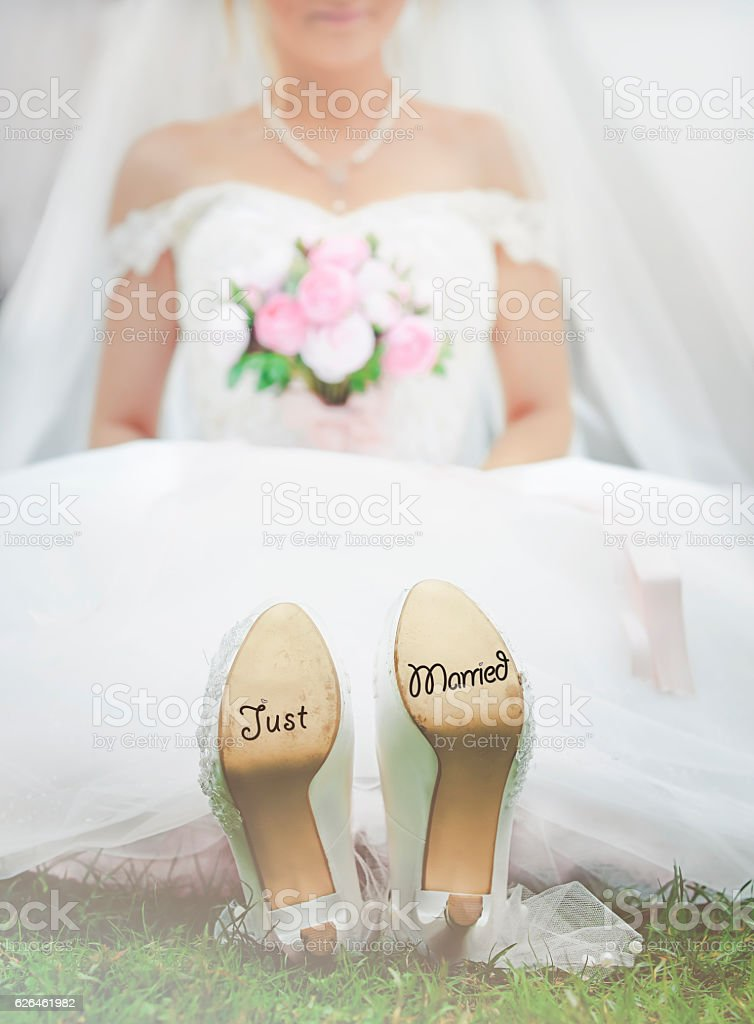 Bride with 'Just Married' written on shoes stock photo