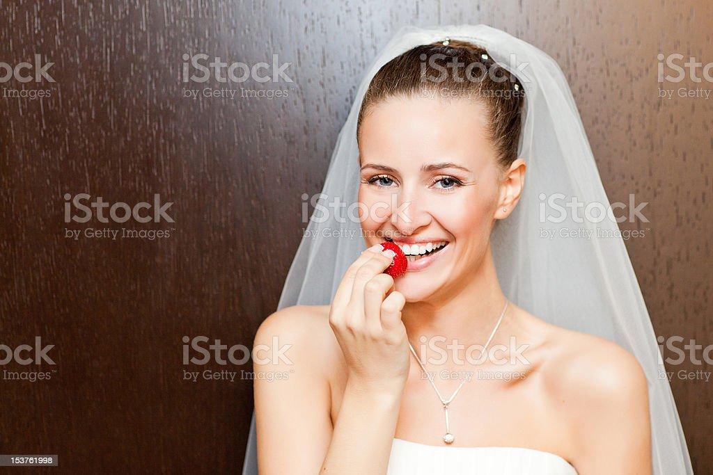 bride with strawberry stock photo