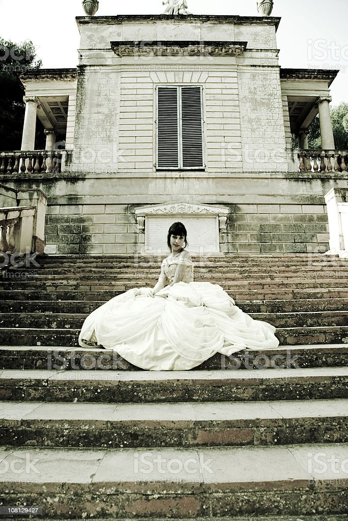 Bride Woman Sitting on Stairs stock photo