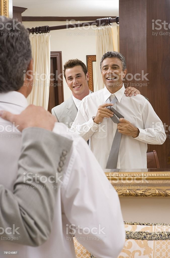Bridegroom and usher getting dressed royalty-free stock photo