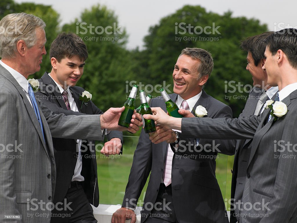 Bridegroom best man and ushers toasting royalty-free 스톡 사진