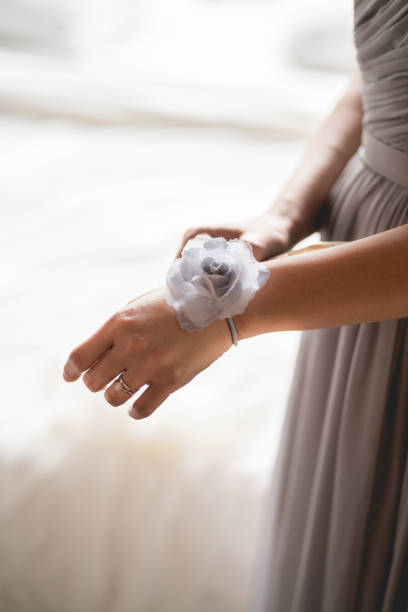 Bridegroom wearing a flower on her hand stock photo