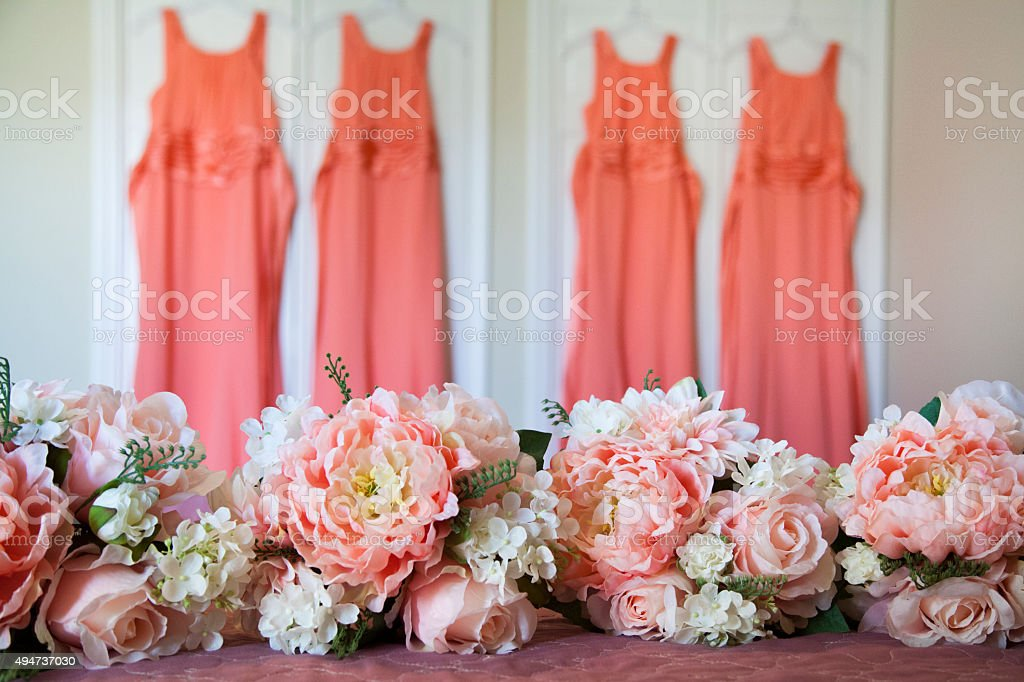 Bridemaids bouquet and dresses stock photo