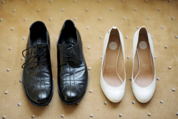 Bride's and groom's shoes Bride's and groom's wedding shoes antipode stock pictures, royalty-free photos & images