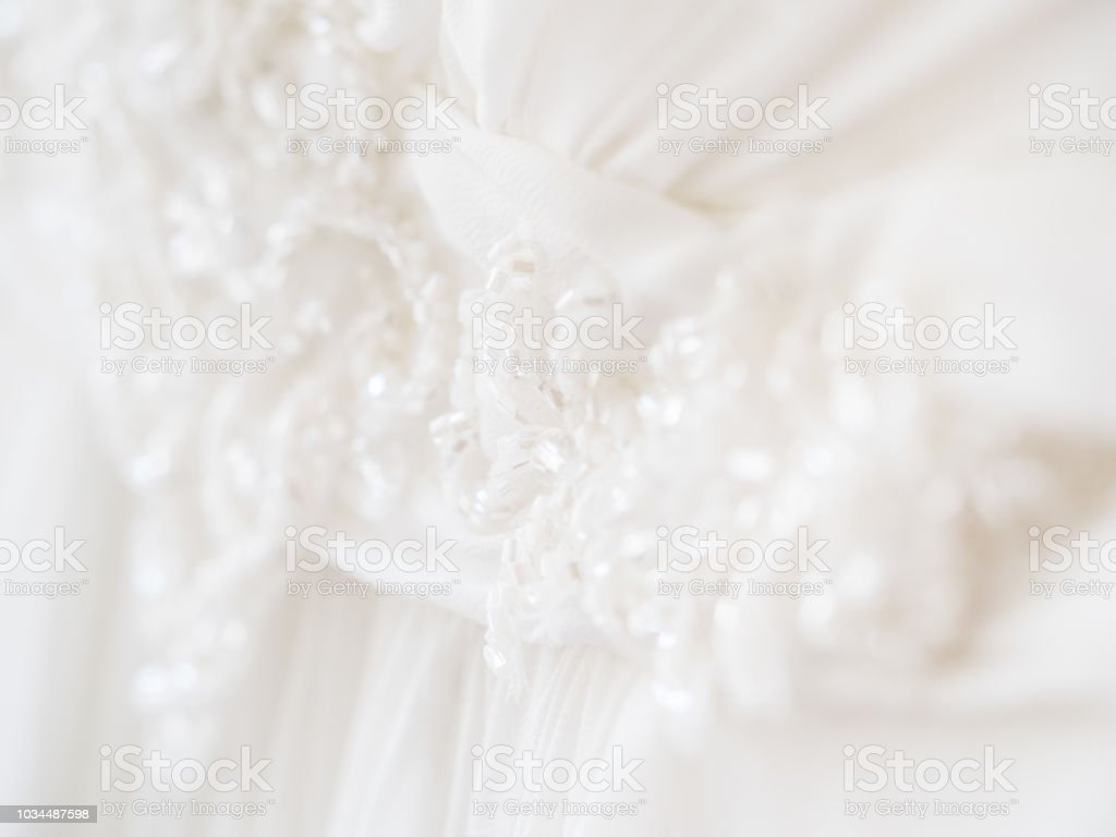 Bride's dress with embroidered elements and beads. Bridal traditional symbolic accessory for wedding ceremony. stock photo