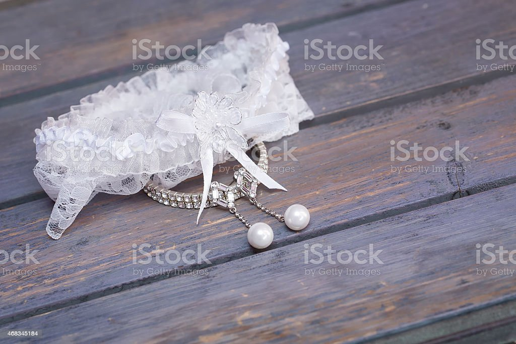 Bride's garter and wedding jewellery stock photo