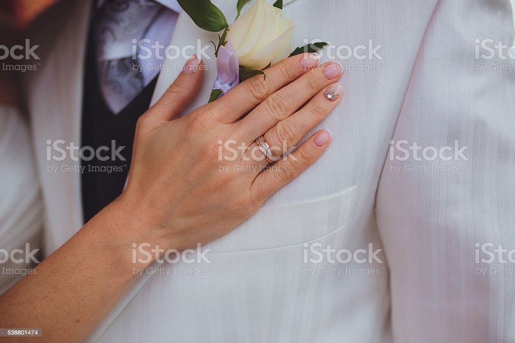 Bride's hand and wedding ring stock photo
