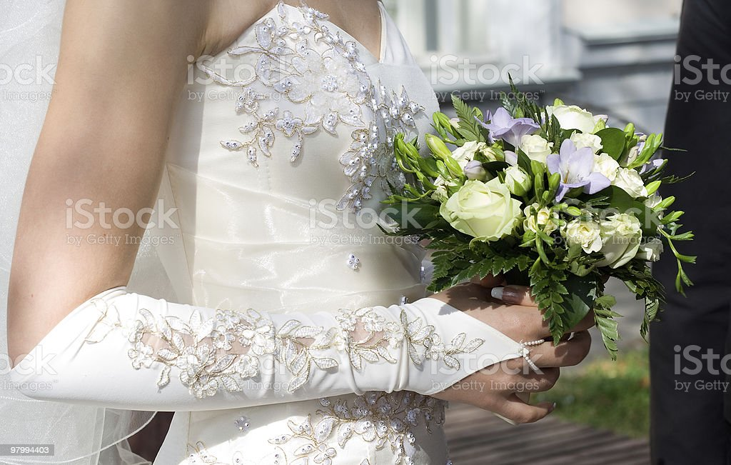 bride's hand holding bunch of flowers royalty-free stock photo