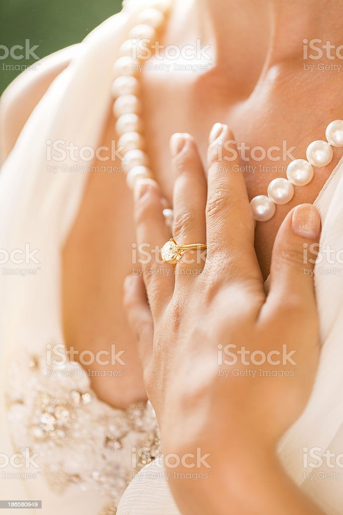 Bride's Hand On Pearl Necklace royalty-free stock photo