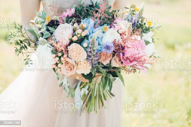 Brides hands hold beautiful bridal bouquet of peony fine art picture id700862288?b=1&k=6&m=700862288&s=612x612&h=wuatzu rntb3n24yzrrzllcfqcjjo kntao7zxpx1ji=
