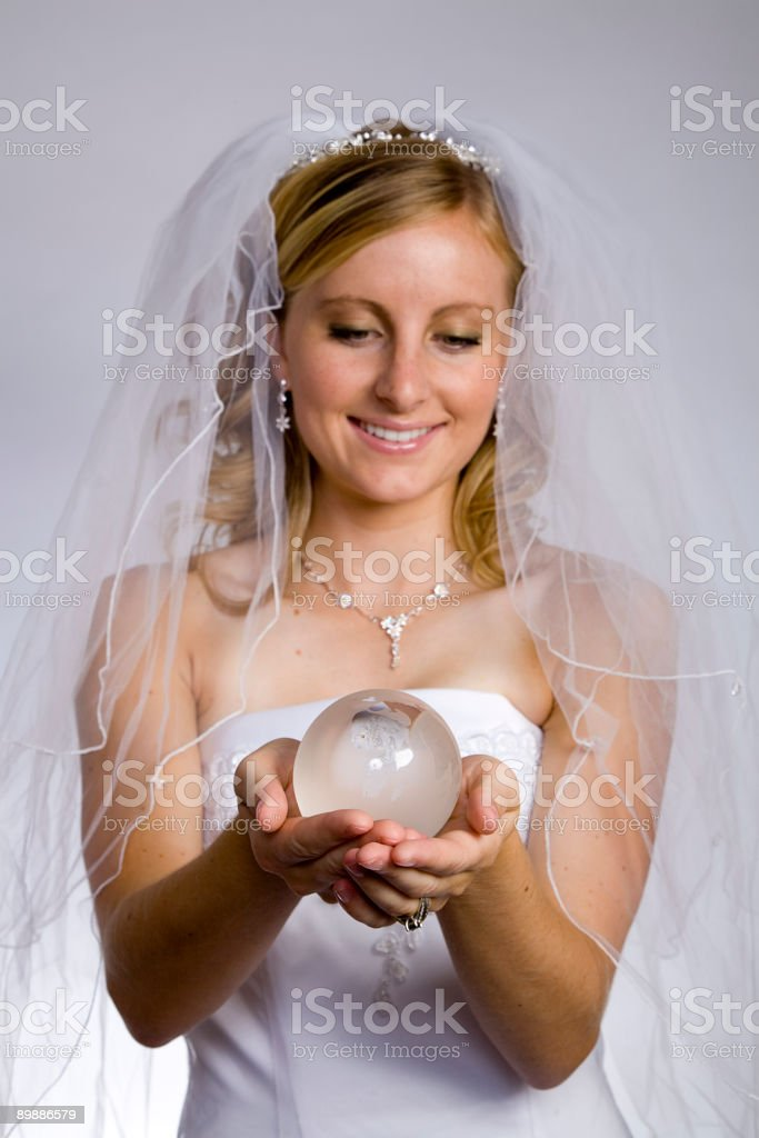 Bride's Holding Globe royalty-free stock photo