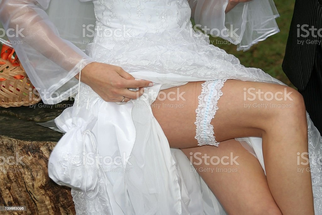 Bride's legs stock photo