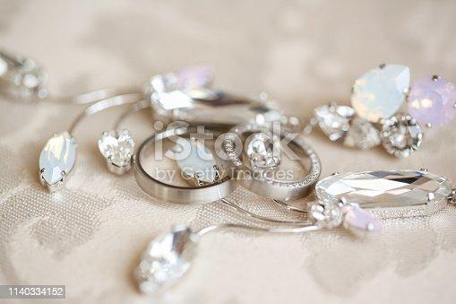 Bride's silver jewels, selective focus