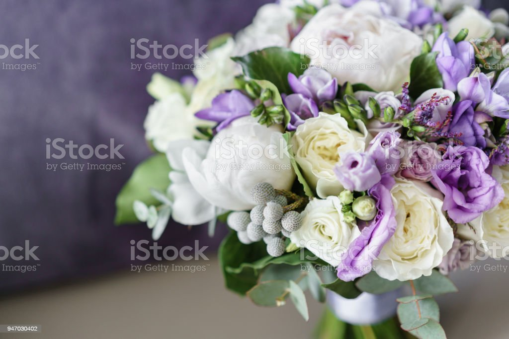Brides Wedding Bouquet With Peonies Freesia And Other Flowers On ...
