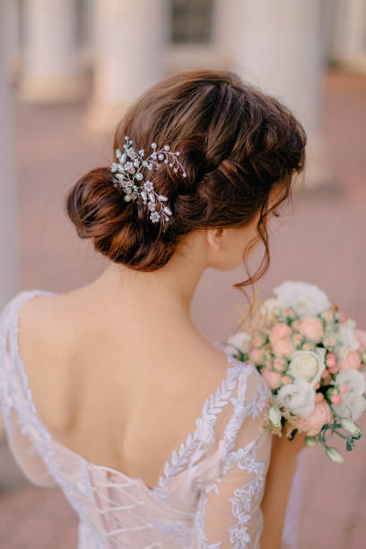 bride's wedding hairstyle from behind stock photo