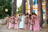 istock Bridesmaid and bride taking a photo together 1185448223