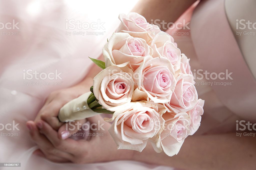 Bridesmaid holding pink rose bouquet stock photo