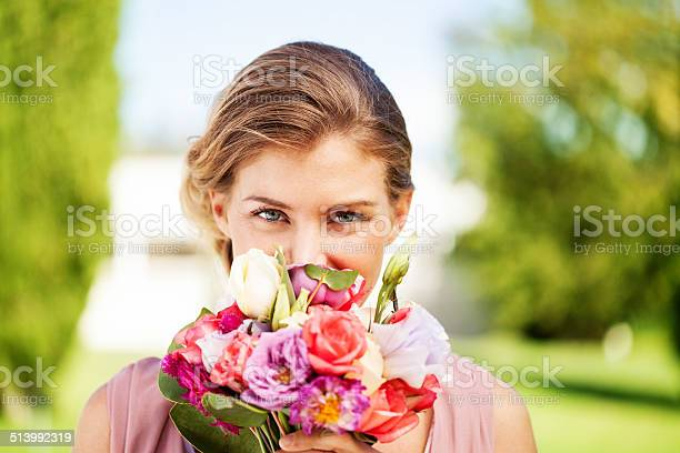 Bridesmaid peeking over flower bouquet at garden picture id513992319?b=1&k=6&m=513992319&s=612x612&h=fuwl6njdj0d4nev x5molu ofdri  7nxbmrm57qfwu=