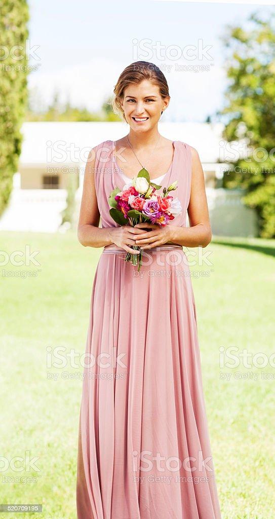 Bridesmaid With Flower Bouquet At Garden Wedding stock photo