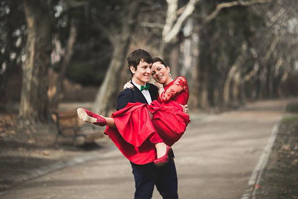 Bridesmaids and groomsmen of wedding couple posing in park stock photo