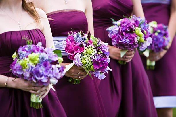 Bridesmaids in a row stock photo