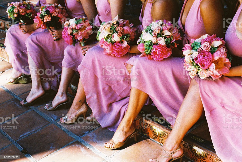 bridesmaids in pink dresses with sexy legs bouquets stock photo