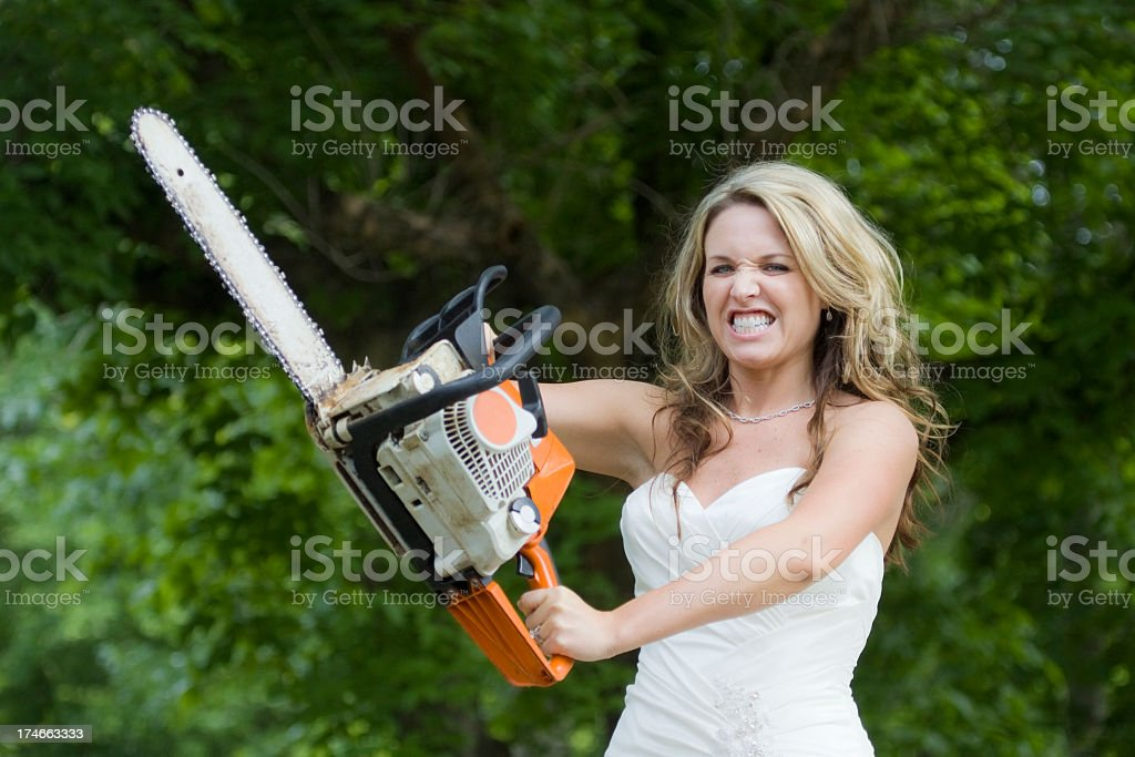 Bridezilla - Bride with Chainsaw royalty-free stock photo