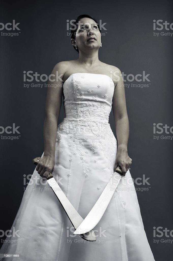 bridezilla with 2 shiny machetes stock photo