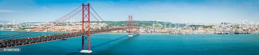 Bridge across blue bay to city beyond Lisbon panorama Portugal stock photo