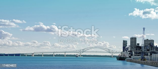 The three kilometer bridge  that spans the St. Lawrence River and docks along the shore in Trios-Rivieres, Quebec.