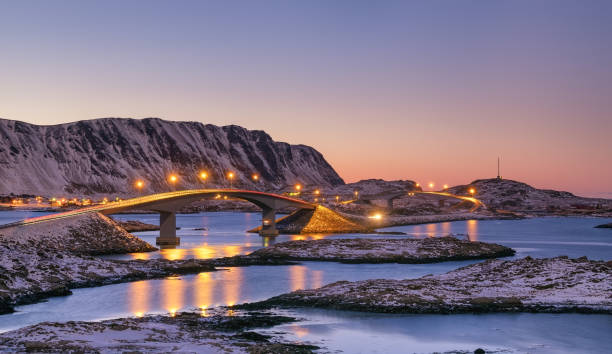 Bridge and high mountains during sunset. Natural landscape in the Norway stock photo