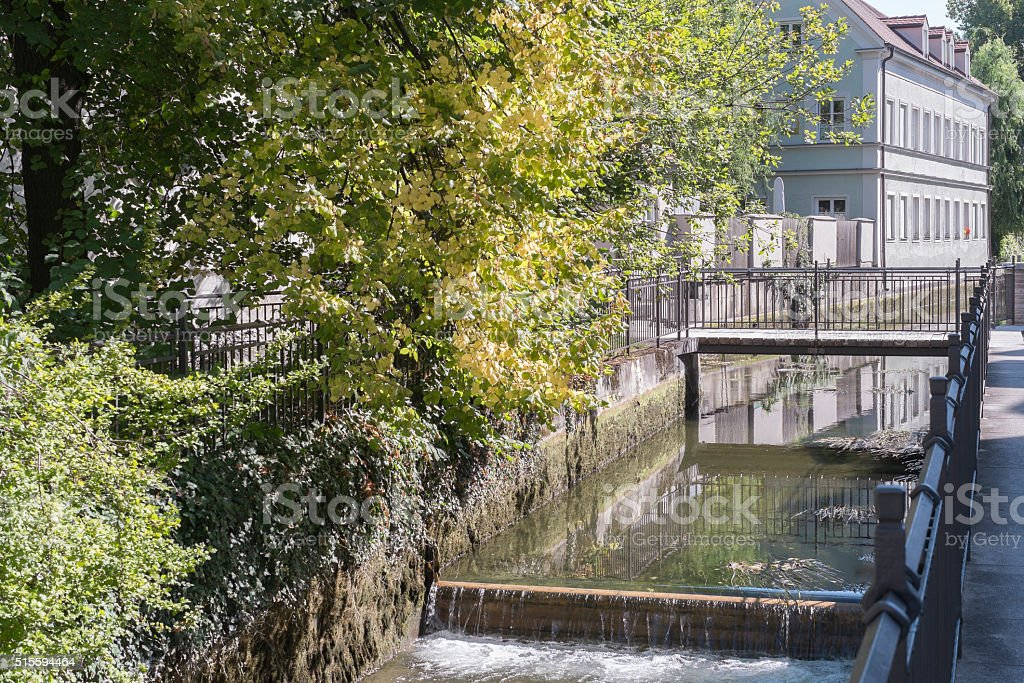 Bridge and water canal in the historic center of Augsburg stock photo