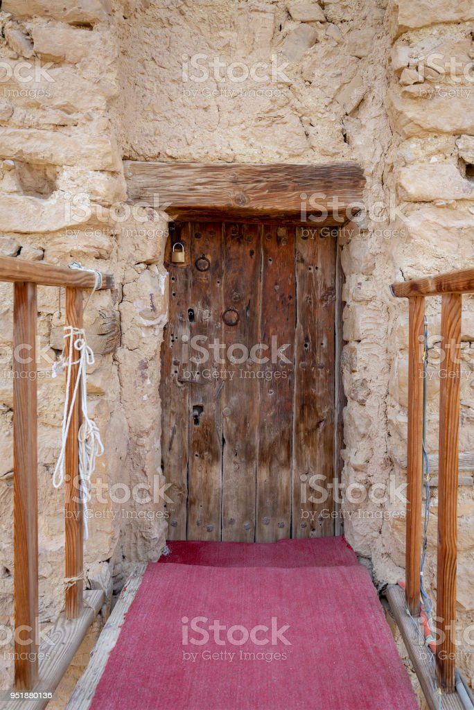 Bridge and wooden door leading to the fort of Monastery of Saint Paul the Anchorite located in the Eastern Desert, mountains, Egypt stock photo